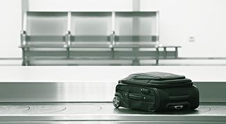 Mala perdida na esteira de restituição de bagagem